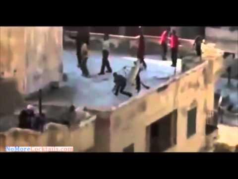 Islamist mob pushes teenage boy off roof and beats him to death - waives Al Qaeda flag