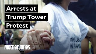 Police make arrests outside Trump Tower after emotional sit-in protest.
