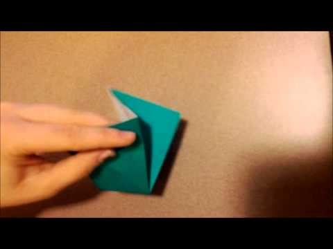 Smallest Origami Crane Folded by Hand Folding an Origami Crane With