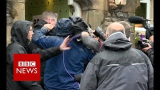 Media scuffle outside polling station - BBC News
