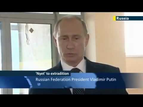 Putin says Kremlin has warned Snowden