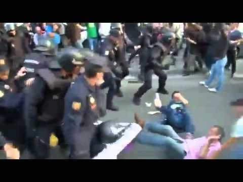 Police Club Anti-Monarchy Protesters In Spain