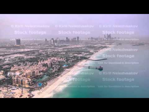 Dubai Marina Skyline night to day from Burj Al Arab. United Arab Emirates timelapse