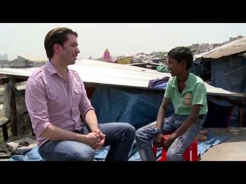 Johnathan Scott Interviews a Young Boy in an India Slum