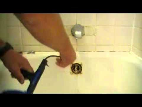 how to snake out a bathtub drain youtube. Black Bedroom Furniture Sets. Home Design Ideas