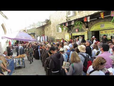 A Catholic procession on Friday at stations 3 and 4 of the Via Dolorosa in Jerusalem's Old City