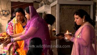 Married women take blessings from older woman after Karva Chauth Puja