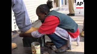 Ethiopian girl pays for education by shining shoes
