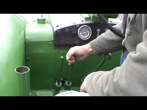 Starting a 1958 John Deere 820 two cylinder diesel tractor