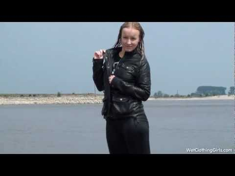 Femke in wet leather jacket and pvc or lack pants