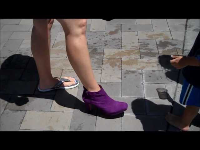 Mom tries on purple boots at the pool