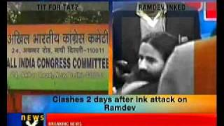 Ramdev supporters throw black ink on Sonia's poster