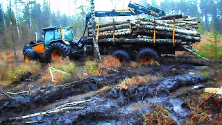 Valtra forestry tractor  stuck in mud, difficult conditions
