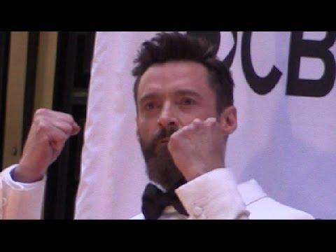 Hugh Jackman jumping  outside Tony Awards