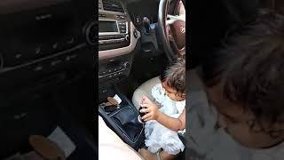 Cute child baby drives a car