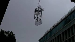 Large Crane Lift On A Windy Day