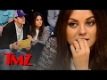 Mila Kunis must be left handed because she can't stop showing off her engagement ring!!!