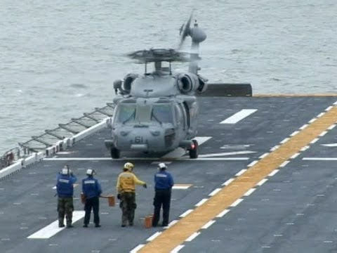 Marines and Sailors Conduct Helicopter Trainig on Amphibious Assault Ship USS Iwo Jima   AiirSource