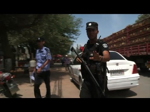 Riots in China's Xinjiang region kill dozens