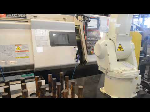 Automated part loading for CNC lathe at a Danish company