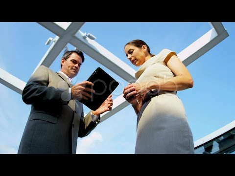 Caucasian Managers Using Internet On Tablet On Rooftop Office . Stock Footage
