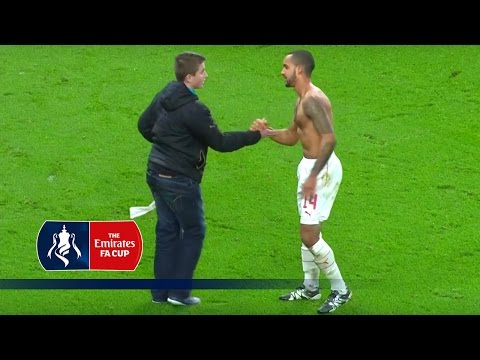 Theo Walcott celebrates with fan after FA Cup game v Sunderland | Snapshots