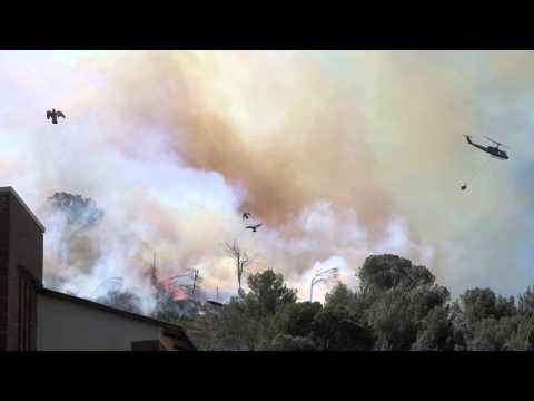Helicopter pilots versus raging wildfires