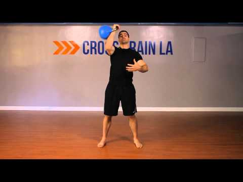 Single-Arm Clean & Press Exercise : Kettlebell Workouts & Exercises Image 1