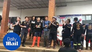 Thai volunteers dance as they celebrate successful rescue mission - Daily Mail