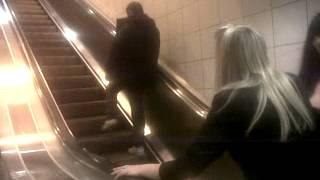 Drunk man falling up an escalator London Bridge lol