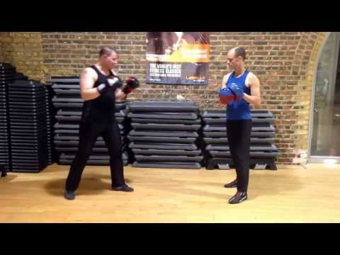 Savate pad work. Fouetté, lead and rear leg. Image 1