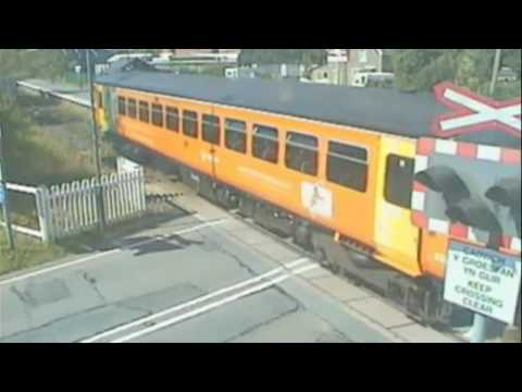 Video shows shocking pram near-miss at level crossing