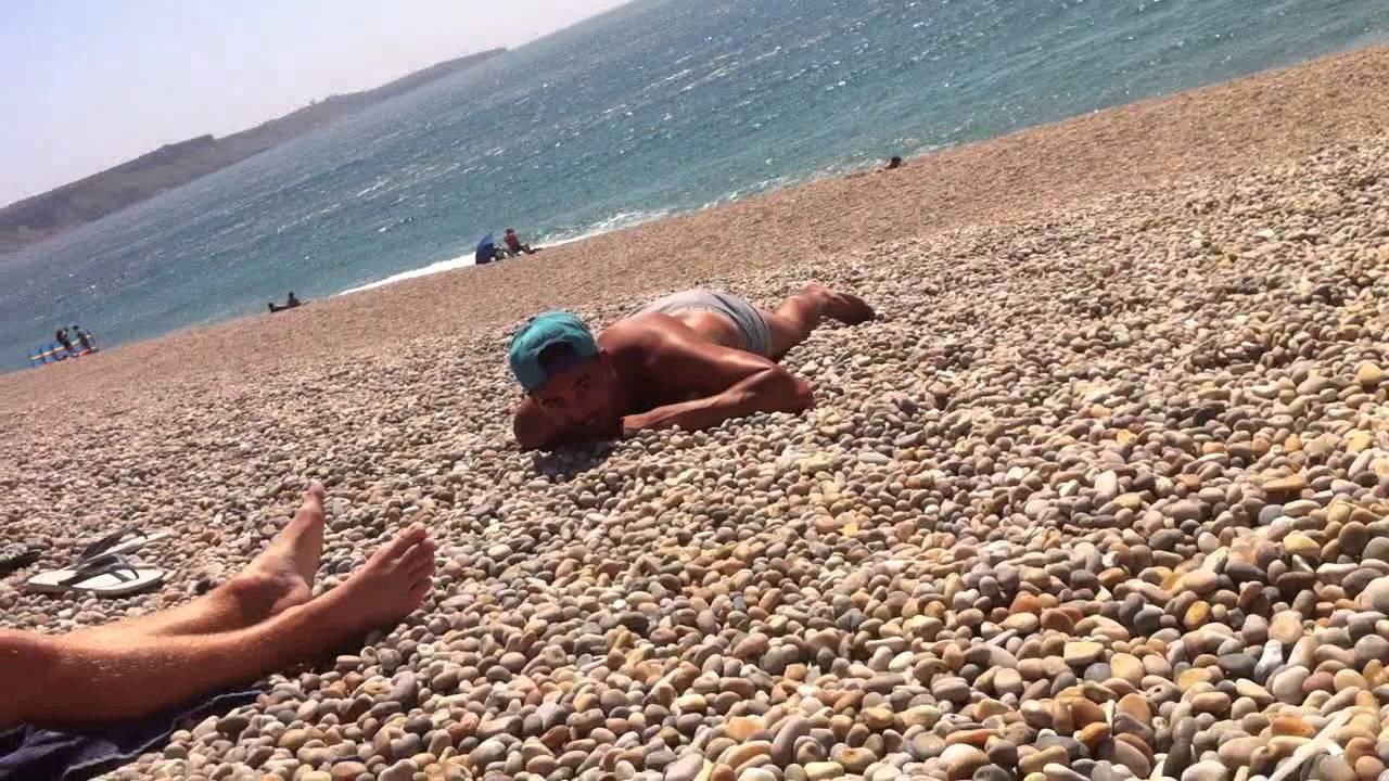 public beach pebble pissing! tooo funny! - YouTube