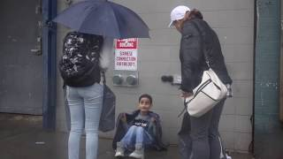 CHILD FREEZING WITH NO UMBRELLA IN THE RAIN (SOCIAL EXPERIMENT)