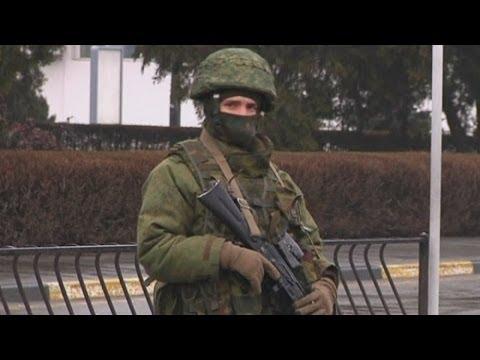 Ukraine crisis: 'Russian forces' seize airports in Crimea region