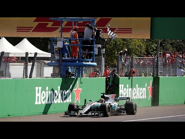 Britain's Lewis Hamilton wins Italian Grand Prix and takes lead in F1 championship