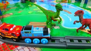 Cars and Trains for kids Thomas and McQueen visit the dinosaurs - Toy Train Video for children