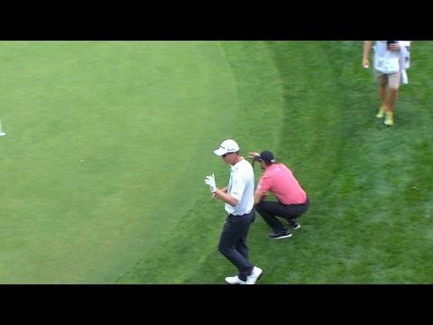 John Senden holes a 29-foot chip for eagle at BMW