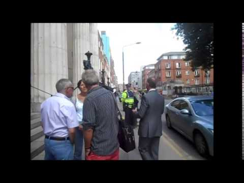 Michael D Higgins Confronted at the Pro Cathedral Dublin