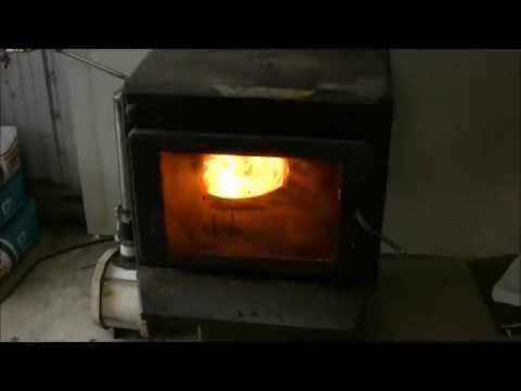 Wood heater converted to waste oil heater