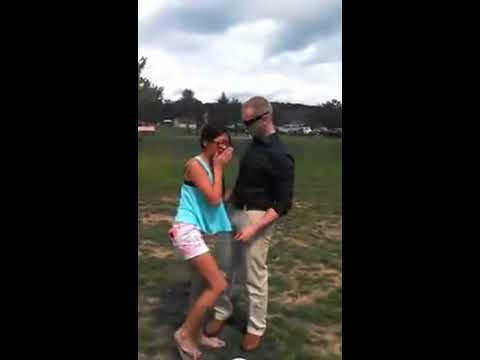 Soldier surprises sister at a soccer game.