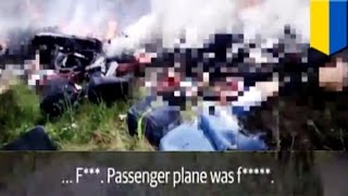 MH17 crash video: shocking footage shows rebels rifling through passenger's luggage