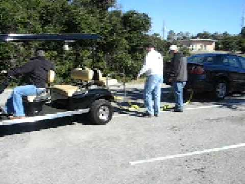 Electric Ruff and Tuff golf cart pulling a stuck car