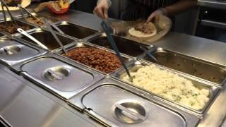 Speedy Chicken and Steak Burrito Made in Chipotle Mexican Grill in Fresno, California