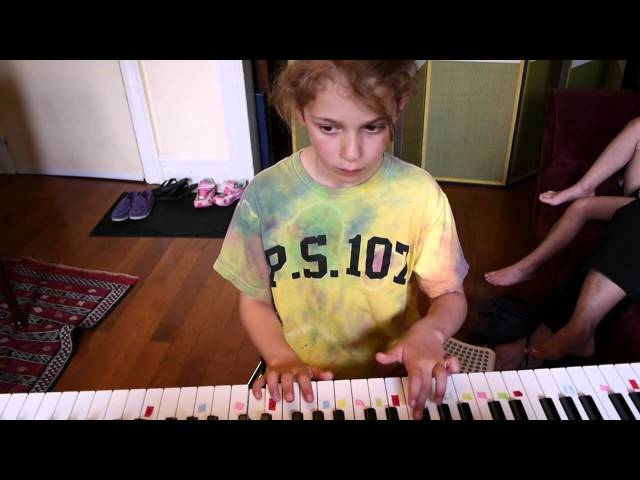 Ava plays Snow Castle Waltz on piano