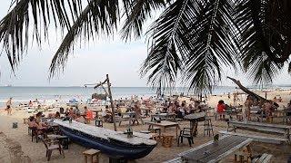 Walking down the street to Trincomalee Beach Sri Lanka