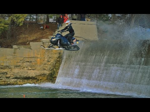 INSANE Snowmobile Dam Jump!!!