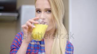 stock footage sexy bottomless woman wearing blue violet shirt only drinking orange juice while at th