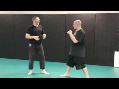 How to Fight: Street Fighting Single Leg Takedown - Snatch Single Wrestling Takedown Image 1