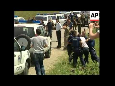 PM visits monastery, police arrest Albanian protesters
